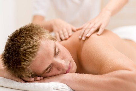 Man having luxury back massage in spa center photo