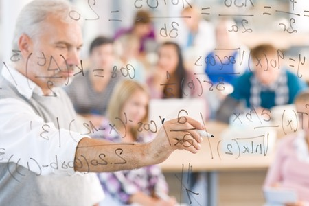 high school students: Math lesson at high school - students with professor in classroom Stock Photo