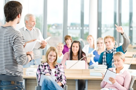 Group of students study in classroom at highschool with professor photo
