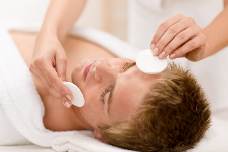 male facial: Male cosmetics - cleaning face treatment at luxury spa Stock Photo