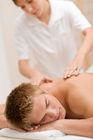 back massage: Man having luxury back massage in spa center