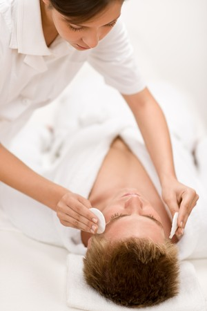 Male cosmetics - cleaning face treatment at luxury spa photo
