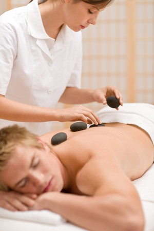 Lastone therapy - man at luxury massage in spa center photo