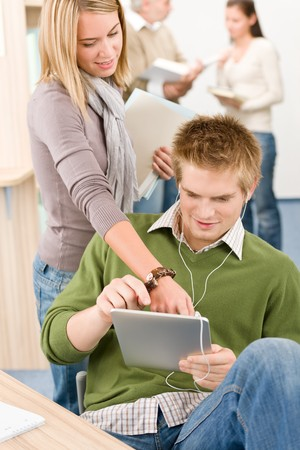 Touch screen tablet computer - group of students in library photo