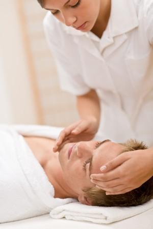 Male cosmetics - facial massage at luxury spa photo