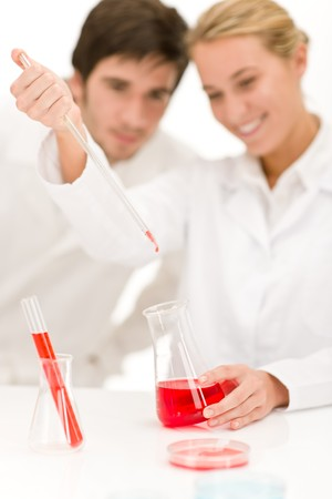 Scientists in laboratory - flu virus test tube with red liquid Stock Photo - 8022862