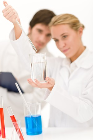 Scientists in laboratory with chemicals testing virus vaccination Stock Photo - 8029105