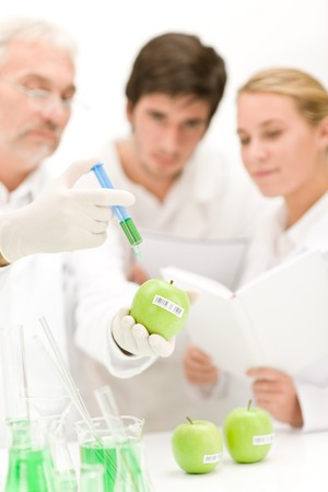 Genetic engineering - scientists in laboratory, GMO testing experiment photo