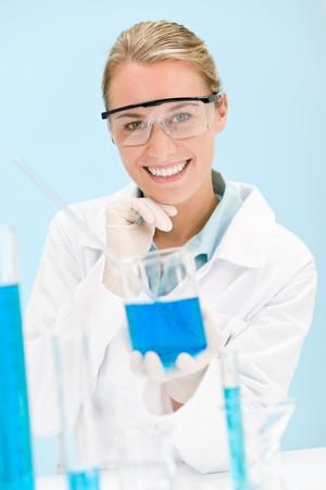 Flu virus experiment -  scientist in laboratory wear protective eyewear photo