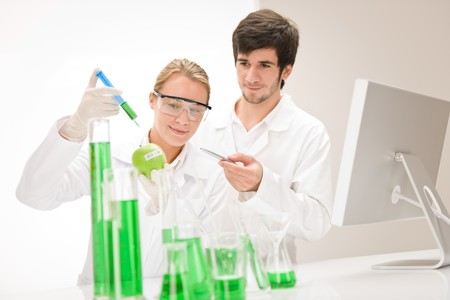chemical engineering: Genetic engineering - scientists in laboratory, GMO testing experiment