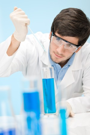 Chemistry experiment -  scientist in laboratory, wear protective eyewear Stock Photo