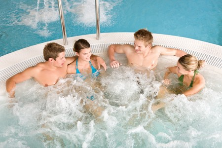 hot tub: Top view  - happy young people relax in hot tub