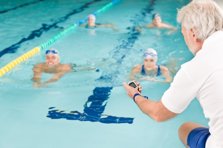 swim goggles: Swimming pool - swimmer training competition in class with coach
