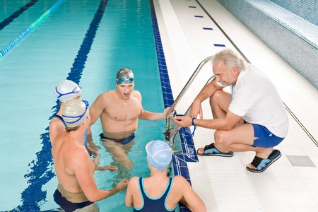 instructors: Swimming pool - swimmer training competition in class with coach