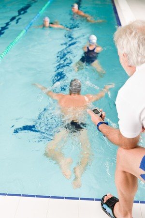 Swimming pool - swimmer training competition in class with coach photo