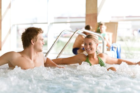 Swimming pool - young attractive couple relax in hot tub Stock Photo - 8109254