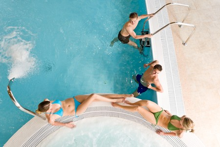 Top view - young people relax in swimming pool at bubble bath photo