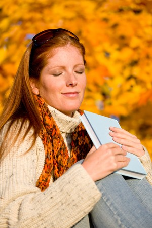 Autumn sunset country - red hair woman holding book Stock Photo - 8162967