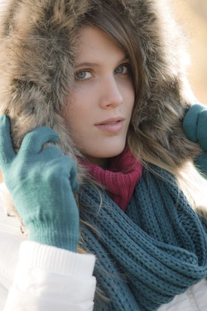 fur hood: Winter fashion - woman with fur hood and gloves outside, desaturated colors