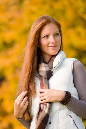 long red hair woman: Autumn park - young attractive long red hair woman fashion Stock Photo
