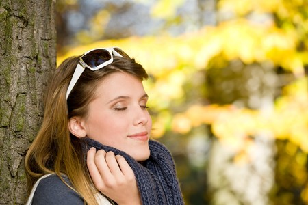 Autumn park - fashion woman with sunglasses on sunny day photo