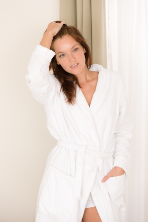 Morning bedroom - woman in bathrobe waking up