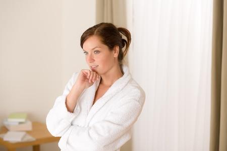 Morning bedroom - woman in bathrobe waking up photo