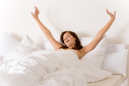 up wake: Bedroom - woman waking up and stretching in white bed