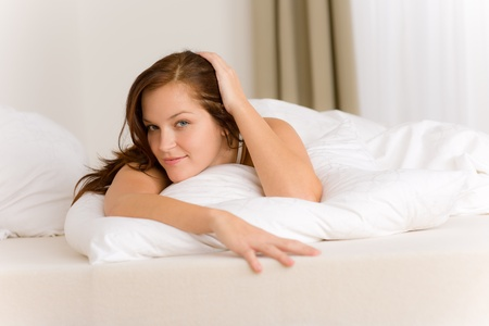 waking: Bedroom - happy woman in white bed waking up Stock Photo