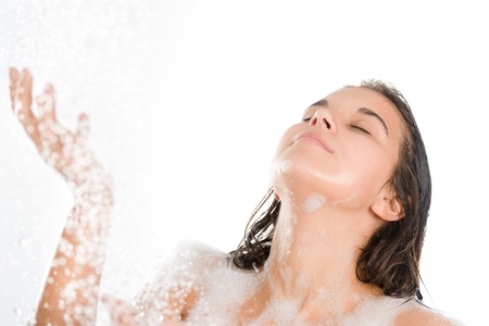 Young woman enjoy shower on white background photo