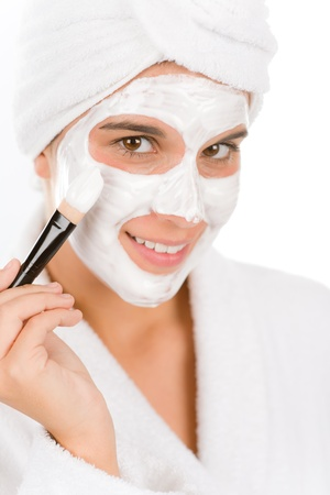 skin care woman: Teenager problem skin care - woman facial mask apply with brush Stock Photo