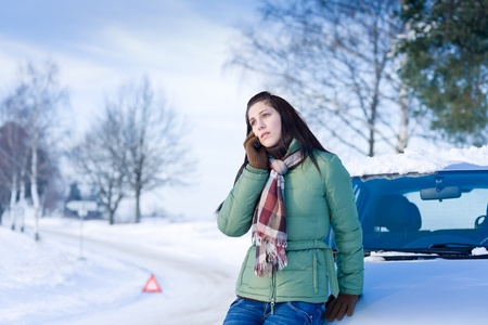 freezing: Winter car breakdown - woman call for help, road assistance