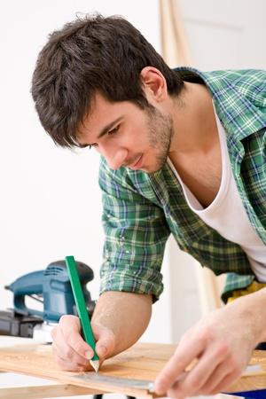Home improvement - handyman prepare wooden floor in workshop photo