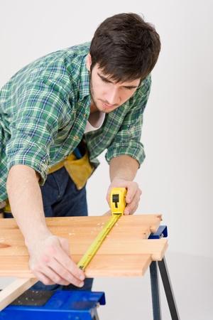 Home improvement - handyman prepare wooden floor in workshop Stock Photo - 8546348
