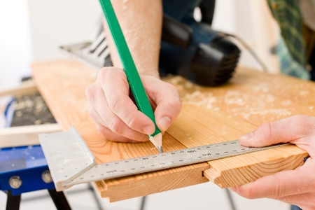 Home improvement - handyman prepare wooden floor in workshop Stock Photo - 8546339
