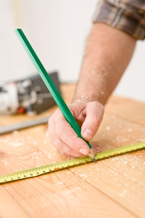 Home improvement - close-up of measuring wood in workshop Stock Photo - 8546336