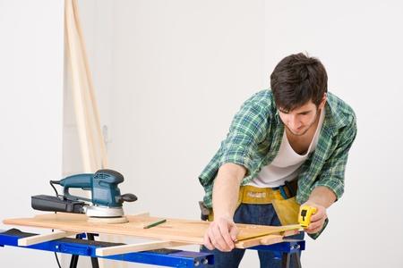 Home improvement - handyman prepare wooden floor in workshop Stock Photo - 8546389