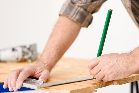 Home improvement - close-up of measuring wood in workshop Stock Photo - 8546386