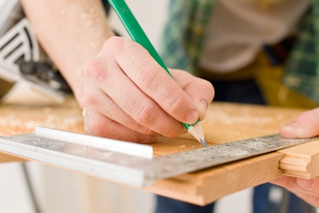 home improvements: Home improvement - handyman prepare wooden floor in workshop Stock Photo