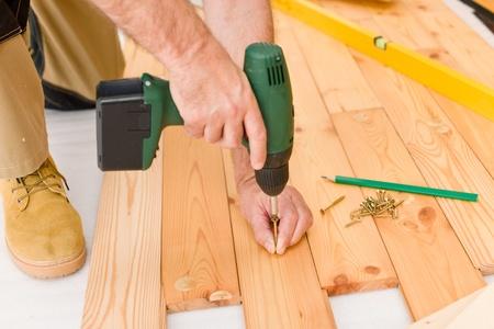 Home improvement - handyman installing wooden floor home Stock Photo - 8569247