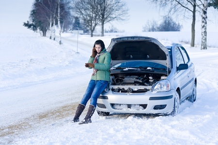 Winter car breakdown - woman call for help, road assistance Stock Photo - 8612489