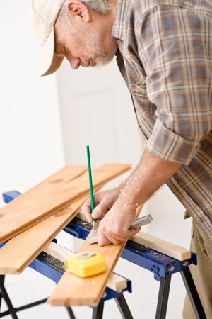 Home improvement - handyman prepare wooden floor in workshop Stock Photo - 8605677