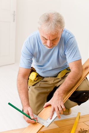 Home improvement - handyman installing wooden floor home Stock Photo - 8605697