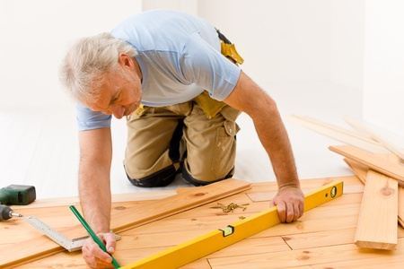 Home improvement - handyman installing wooden floor home photo