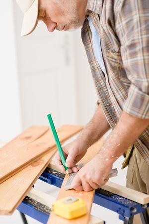 Home improvement - handyman prepare wooden floor in workshop Stock Photo - 8641931