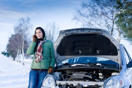 damaged cars: Winter car breakdown - woman call for help, road assistance