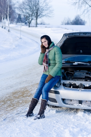 Winter car breakdown - woman call for help, road assistance photo