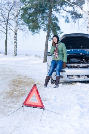 road assistance: Winter car breakdown - woman call for help, road assistance