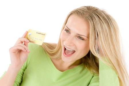 Home shopping - young woman holding credit card on white background Stock Photo - 8686714