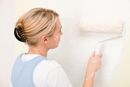 handywoman: Home improvement - handywoman painting wall with roller